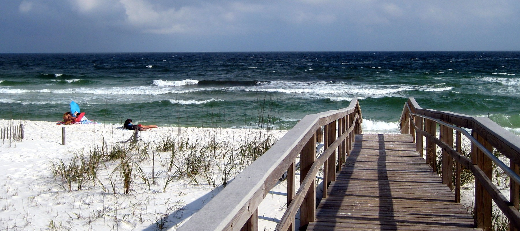 Pensacola, Florida, view, looking out on a wooden walkway to the beach and ocean.