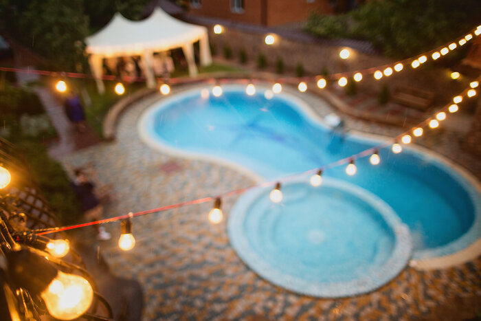 Garland light suspended over a swimming pool.