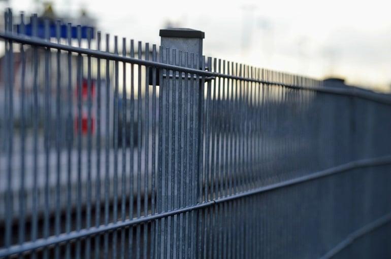 Close up of a plain aluminum security fence