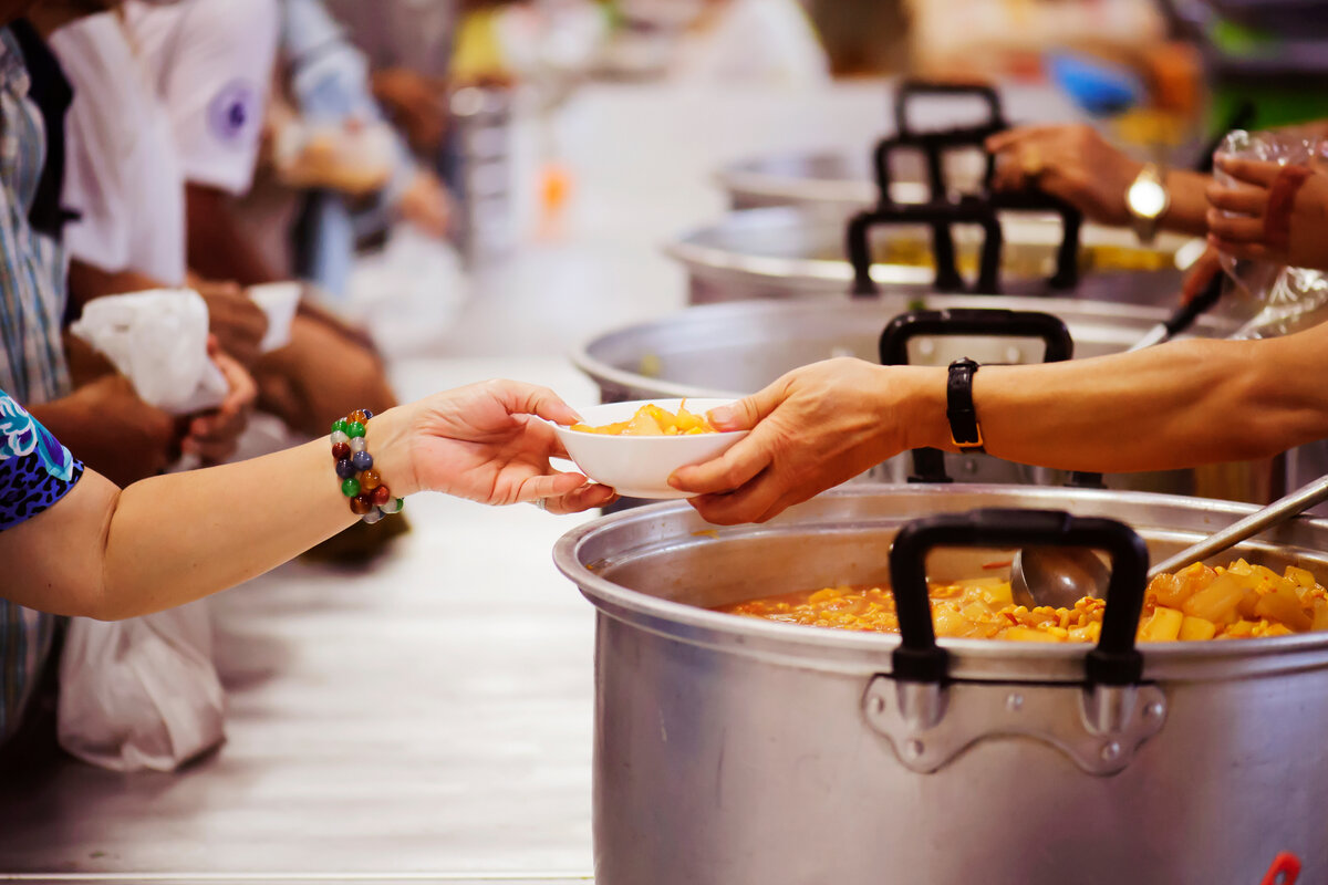 Volunteers feeding the hungry at a soup kitchen