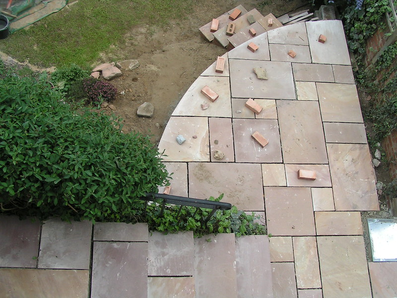 Partially built patio using pavers and brick