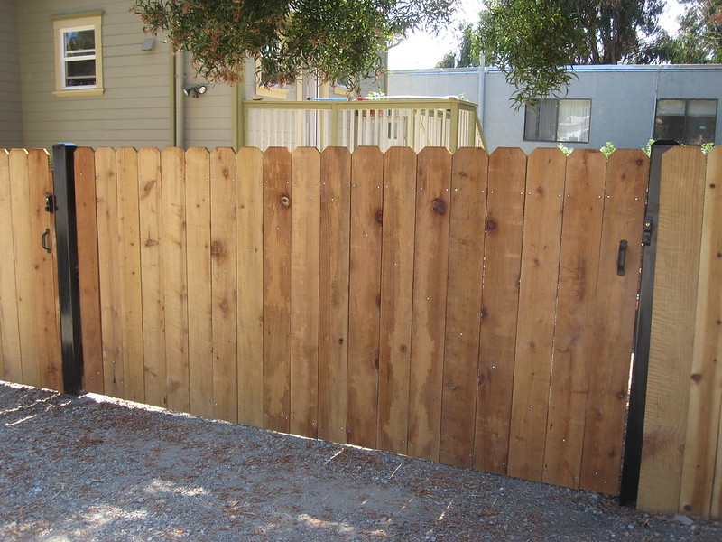 Wooden fence with house in the background