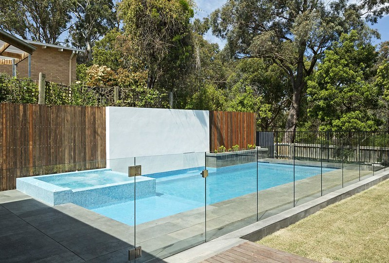 Glass fence surrounding an outdoor pool