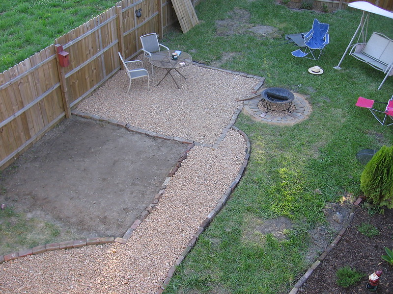 Aerial shot of a backyard with a patch of ground being prepped for building on top of it