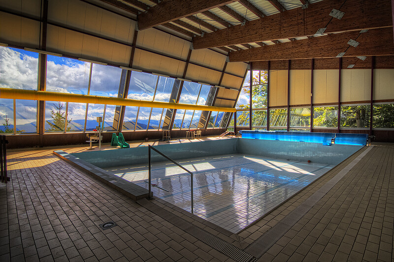 Indoor pool with full-sized glass windows around it