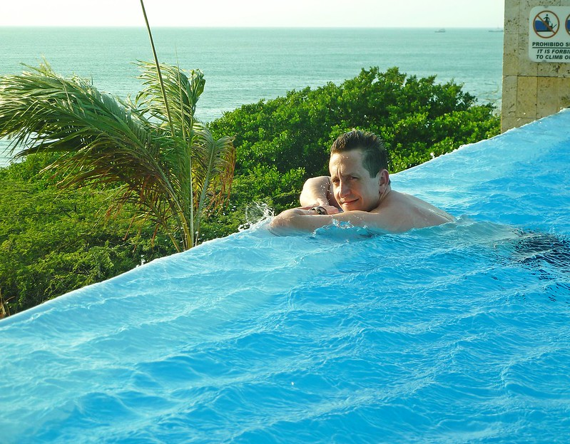 Man leaning on the edge of an infinity pool