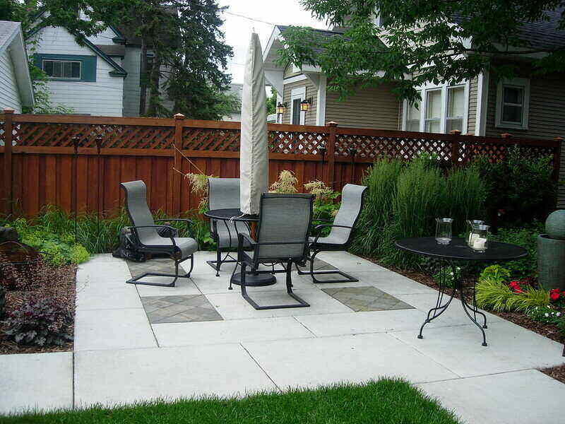 Concrete pavers patio with a table and chairs