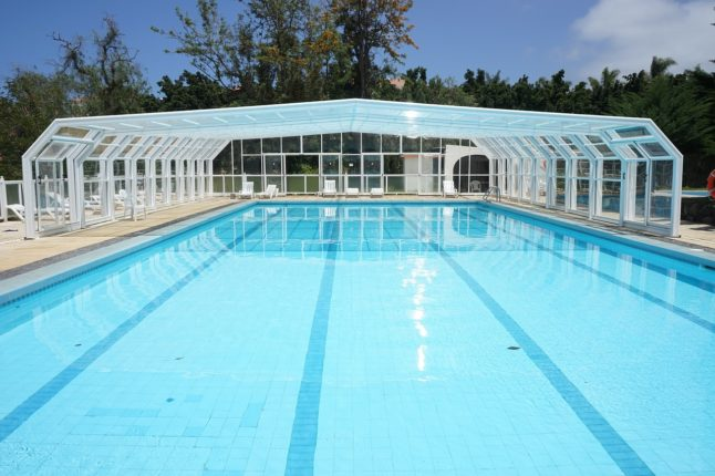 swimming pool with glass enclosure